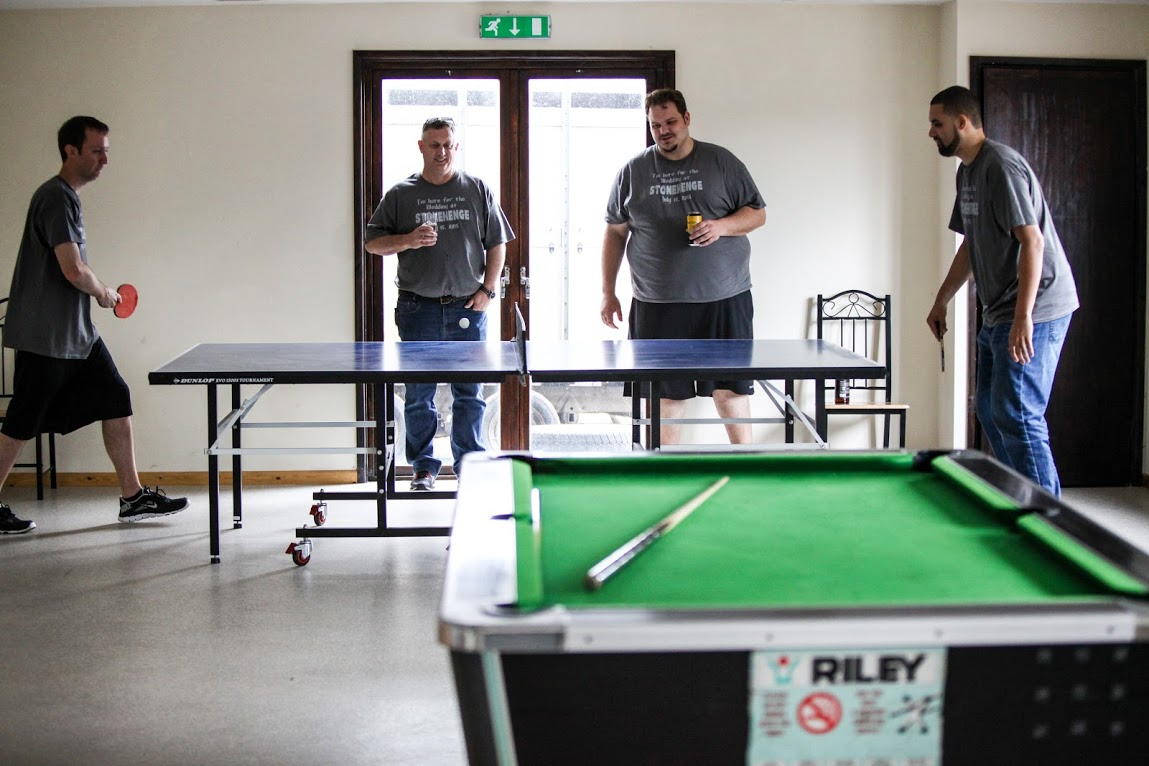The groom and best man are relaxing playing table tennis