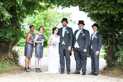 The happy couple, best man and bridemaids